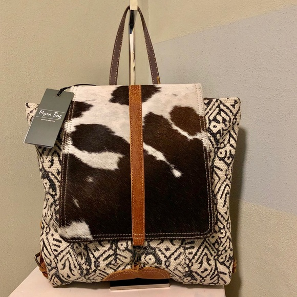Myra Bag Bags Myra Bag Backpack Cow Hide Cotton Rug Purse Nwt Poshmark All bags must have a warranty authorization number before being sent to one of our repair centers. poshmark